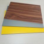 Circular Cladding Wood Grain Aluminum Composite Panel Embossed Surface Density 2.5% Manufactures