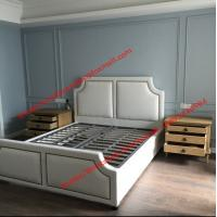 White fabric bed with copper nail decoration and slat wood support in black metal rack for spring mattress Manufactures