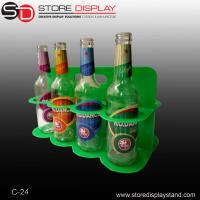 Plastic counter top display for carrying beer bottles Manufactures