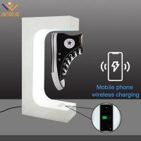 China wireless charging rotation magnetic levitation floating shop shoe display stand on sale