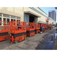 Quality Safety Load 320KG Hydraulic Scissor Lift With Working Height 13.8m Orange Color for sale