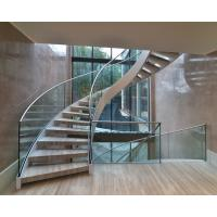 Elegant interior wooden curved staircase with 50mm solid oak wooden treads Manufactures