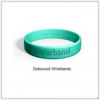 China 100% Silicone Customized Silicone Bracelets with Debossed Phrase on sale