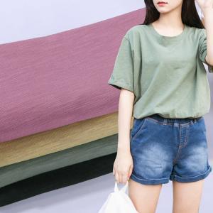China Stock Lot Mercerized 200gsm Slub Plain Dyed Cotton Spandex Fabric For Garment on sale