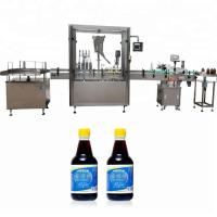 China PLC Control Glass Bottle Capping Machine With 4 Nozzles 750ml - 1000ml Filling Volume on sale