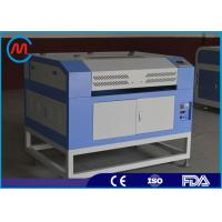 60w Small Plastic Laser Cutting Machine Blade Table Sealed Co2 Glass Tube Manufactures