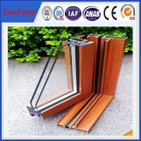 Popular wooden grain aluminium extrusion profile for sliding window & door Manufactures
