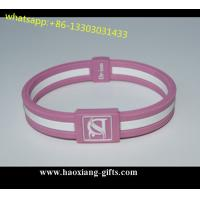 China custom 202*12*25*2mm debossed logo pink silicone wristbands/bracelets on sale