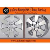 China 4 Hole 14 inch Nissan custom car wheels For LIVINA With OEM Caps on sale