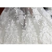 China Embroidery Floral Corded Ivory Lace Fabric By The Yard For Luxury Wedding Dress on sale