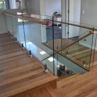Stainless steel spigot clear glass railing with wooden top handrail design Manufactures