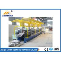 2018 new type PLC Control Full Automatic Shutter Door Guide Roll Forming Machine yellow color Manufactures