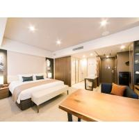 Christchurch modern hotel interior design furniture of Laminate board TV wall unit with writing desk and Upholstered bed Manufactures