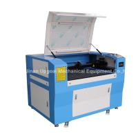 Hot Sale Advertisement Co2 Laser Engraving Cutting Machine with 900*600mm Size Manufactures