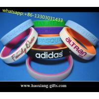 Quality Custom Promotional Adjustable Silicone Wristband/bracelet with debossed logo for sale