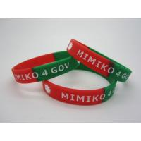 China segemented with two colors and logo debossed silicone bracelet wristband on sale