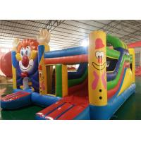 China Slide Huge Commercial Bounce House Smiling Face Image Lead Free Strong Struture on sale