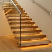 Floating stairs with wooden tread and frameless glass railings Manufactures