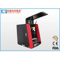China Enclosed Mini Fiber Laser Marking Machine for engrave small electronic parts on sale
