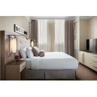 laminated Oak wood Hotel bedroom Furniture sets Tall headboard with Fabric upholstered padded and TV units Contemporary Manufactures