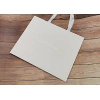 Degradable Cloth Carrying Kraft Paper Packaging Bags With Hot Stamped Logo Manufactures