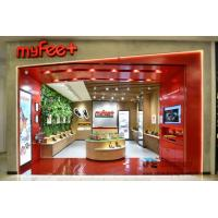 Brand slippers retail store interior fit out work by Cheap panel display furniture by Circular counters and Wall shelves Manufactures