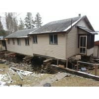 Screw pile foundation under existing cabin for sale of for Piling for house foundations