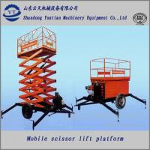 Electric and Diesel engine dual fuel four wheels mobile scissor lift platform Manufactures