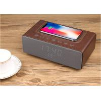 China Hot 4 in 1 design wireless charger bluetooth speaker with alarm clock and led light on sale