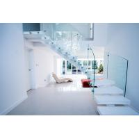 Interior white color curved staircase with glass railing design Manufactures