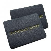 China apparel genuine leather label stamped tags black leather patch logo factory on sale