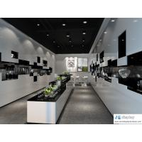 Glass arts and crafts store display cabinet by white wood panel and black marble counters Manufactures