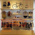 Kids clothing kiosk design with clothing display racks Manufactures