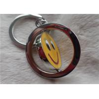 Color Silver Key Chain Personalized Promotional Gifts With Rotatable Smiling Yellow Face Manufactures
