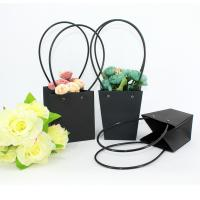 Waterproof Flower Packaging Carry Kraft Paper Bag With Plastic Handle Manufactures