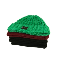 Popular unisex warm all colors customize woven label winter knitted boonies hats Manufactures