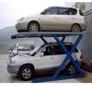Scissor Type Simple Car Parking Lift Hot Sale Electric Hydraulic Scissor Car Parking Lift 2700kg/2000mm for Home Garage Manufactures