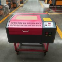 Quality RUIDA control 50W 4040 laser engraving and cutting machine with red point and honeycomb for sale