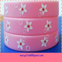 China pink custom printed silicone bracelets with flower logo on sale