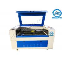 Cnc CO2 Laser Cutting Engraving Machine With Channel Type Feeding Manufactures