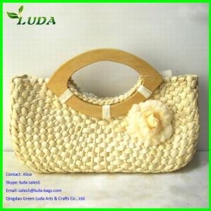 China 100% handmade woven fashion corn husk straw beach bags on sale