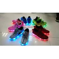 China latest sports shoes for men and women with led on sale