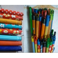 Wood mop handle covered with shrink film Manufactures