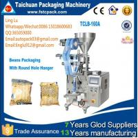 low cost Fully automatic white pellet sugar bag packing machine,3 sides sealing bag Fully automatic white pell Manufactures