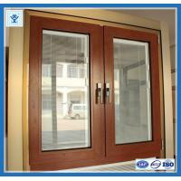 China Modern house aluminium sliding window in wooden color with grill design on sale