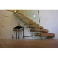 Clear glass railing floating stair with anti slip slots on steps Manufactures