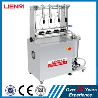 China 4 heads Semi automatic Filling Machine for Perfume nail polish vacuum liquid filler equipment for glass bottles on sale