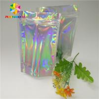 China Custom Printing Plastic Cosmetic Bags Three Side Seal Hologram Laser Wateproof Pouch on sale
