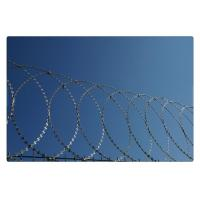 China Flat Wrap Coiled Razor Wire Hdg Hot Dipped Galvanized For Security Barrier on sale
