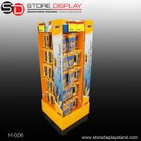 Customized durable four sides floor display stand with hooks for hanging Manufactures